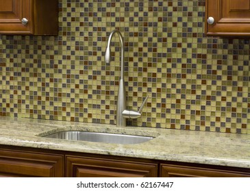 Stainless steel kitchen faucet and sink with mosaic  back splash