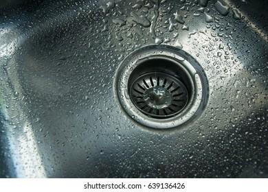 a stainless steel kitchen sink drain