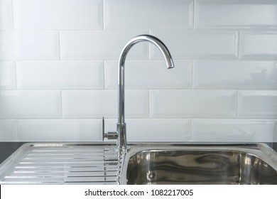 stainless steel kitchen sink on white worktop