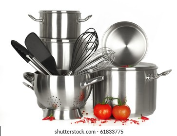 stainless steel kitchen tools, pot, pan, wire whisk on white Background