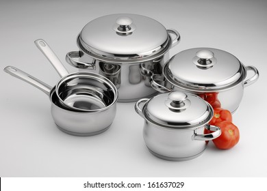 stainless steel kitchenware on neutral background