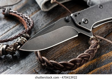 stainless steel pocketknife with blackwash finish on blade and handle,shallow depth of field