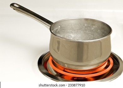 Stainless Steel Pot On Red Hot Electric Burner On Stove
