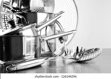 Stainless steel pots and utensils on table counter