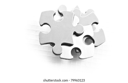 Stainless steel puzzle pieces on white background with space for text
