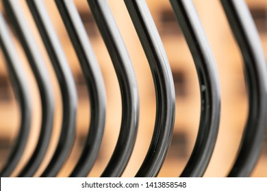 Stainless steel railing around the building balcony.Abstract background of curves
