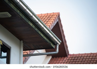 stainless steel rain gutter on top of roof.