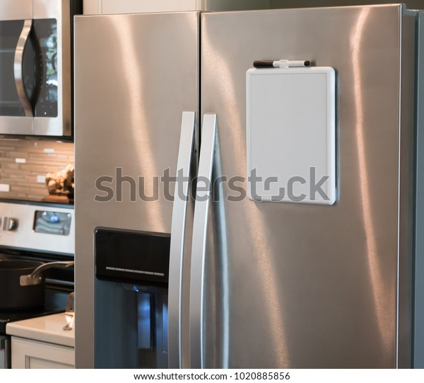 Stainless steel refrigerator with a magnetic dry erase whiteboard