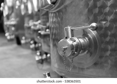 Stainless steel reservoirs for wine, closeup