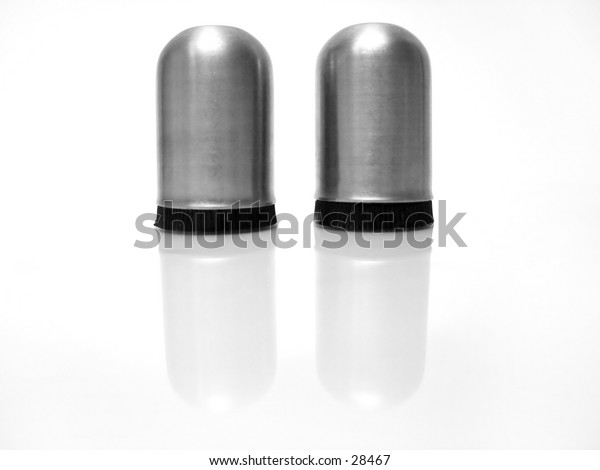 Stainless steel Salt and pepper shakers on reflective background