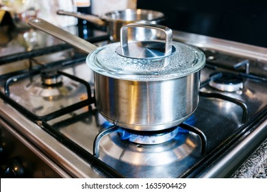 stainless steel saucepan  at the kitchen fire with boiling water