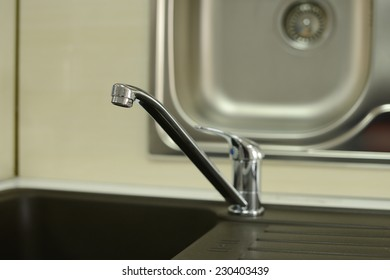 Stainless steel sink with drain. Closeup. Close up of washbasin in a kitchen