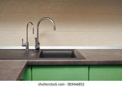 stainless steel sink and faucet in kitchen