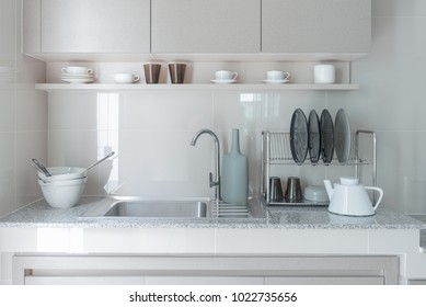 stainless steel sink with faucet on kitchen counter in modern kitchen room style