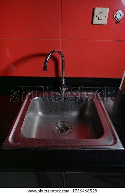 Stainless steel sink kitchen ware close up view
