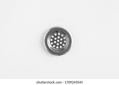 Stainless steel sink strainer on a white background. view from above.