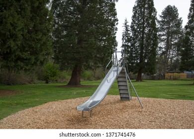 Stainless steel slide in a community park.