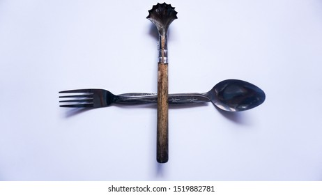 stainless steel spoon, fork and coconut scraper , stacked mode.