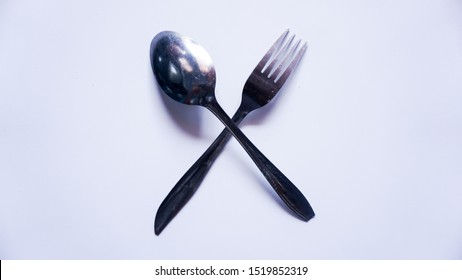 stainless steel spoon and fork, cross mode, type 1, white background