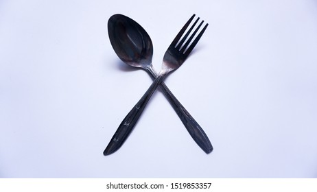stainless steel spoon and fork, cross mode, type 2, white background