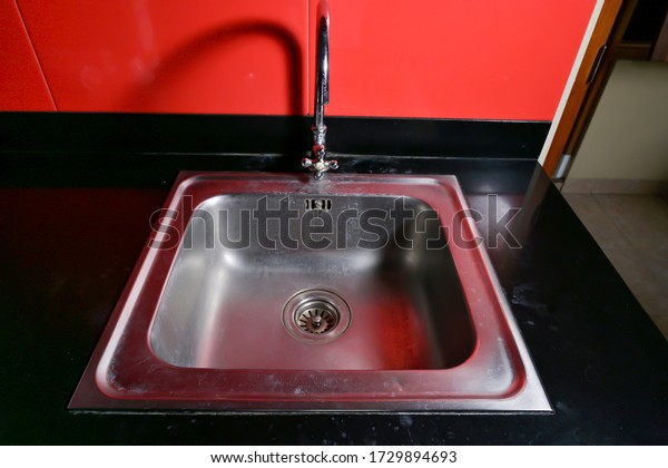 Stainless steel square sink on black granite table ifor modern kitchen interior design