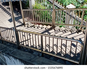 Stainless steel stair rails and concrete staircases that has shadow.