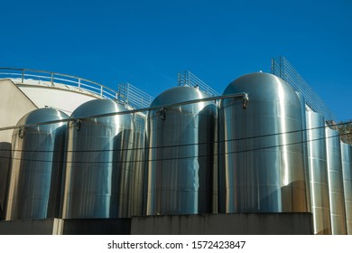 Stainless steel storage tanks for grape juice or wine production, at the Aurora Winery facilities in Bento Gonçalves. A friendly country town in southern Brazil famous for its wine production.