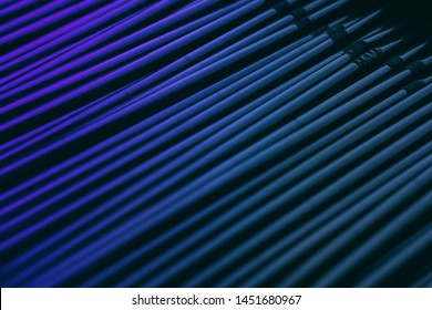 Stainless steel straws vertical abstract background. Metal pipes bundle side view decorative texture. Shiny metallic, aluminium hollow tubes in blue and violet colors backdrop for modern design