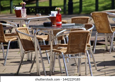 Stainless Steel table and chairs outside a cafe for al fresco dining.