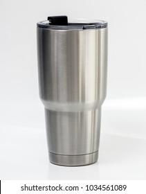 Stainless steel thermos tumbler mug on white background.