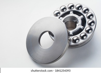 Stainless steel thrust ball bearing. Set of thrust ball bearing and shiny silver ball bearing. Spare parts for roller machine in heavy machinery and automotive or high-pressure washing industry.