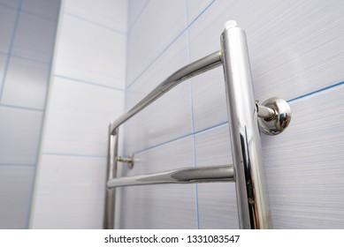 Stainless steel towel hanger on wall in bathroom