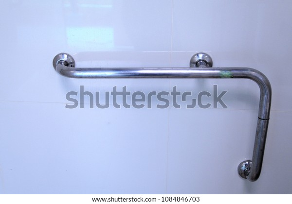 Stainless steel towel hanger on grey cement wall in bathroom,Long New Stainless Steel Towel Holder Rack on a white background