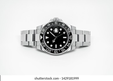 Stainless steel watch, black dial on white background.