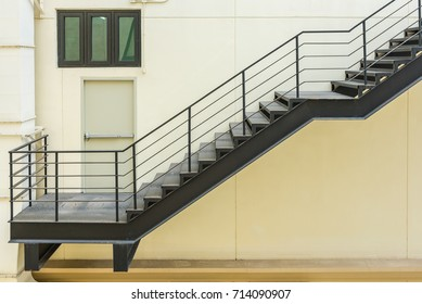 stair for fire escape with the steel railing and ladder on side of building