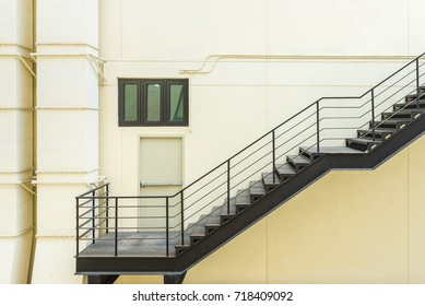 stair for fire escape with the steel railing and ladder on side of buliding
