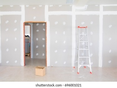 stair and gypsum board wall interior decoration of home at construction site with copy space add text