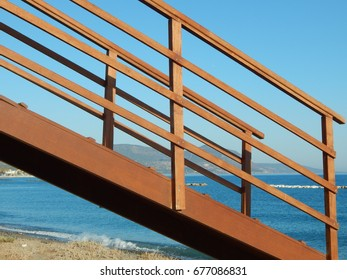 Stair structure leading down onto sand beach at Polis, Cyprus.