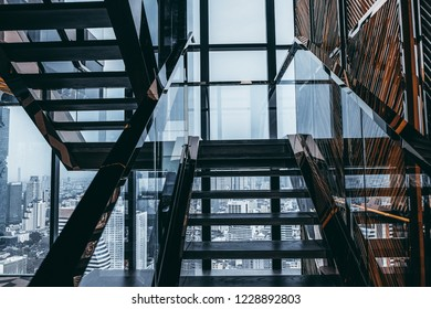 Stair way with miror reflection and panoramic view of skyscapers in background
