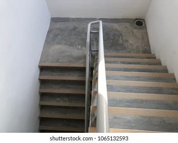 Staircase appartment with rain water down pipe point at the corner