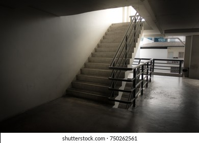 Staircase in car park building. Modern interior design of staircase in building emergency exit.