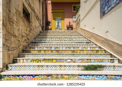 Staircase of decorated ceramic tiles leading up from the fishing port of Sciacca. Sciacca, Sicily, Agrigento province, Italy, May 2018