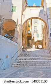 The staircase and decorative medieval gate located between the Square of Saint-Michel and Mattoni street in old Menton, France.