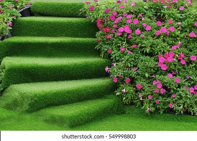 staircase Green artificial grass with ping flower on tree