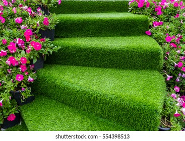 staircase green artificial grass with pink flower