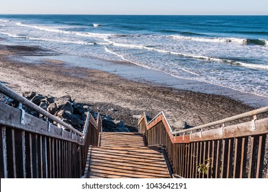 Staircase headed down to beach at South Carlsbad State Beach in San Diego, California.