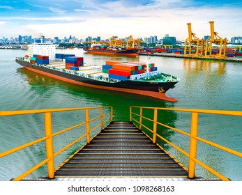 Staircase of large cargo ship,large shipping crane featuring stairs. ship cargo containers loading to harbor by crane, with export and import business and logistics.