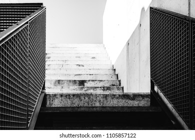A staircase made of concrete that leads to the top
