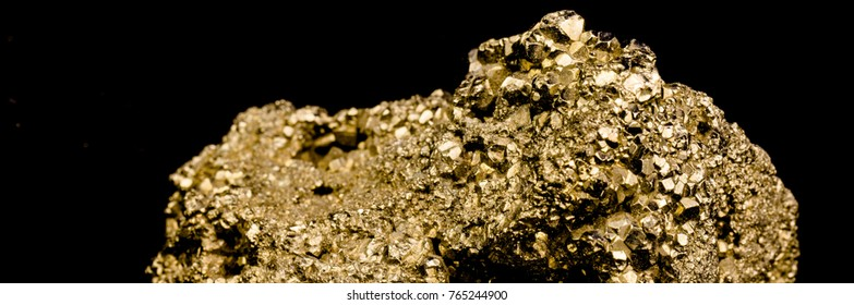 Staircase made of many cubic pyrite crystals, cropped, close-up, false gold, background black
