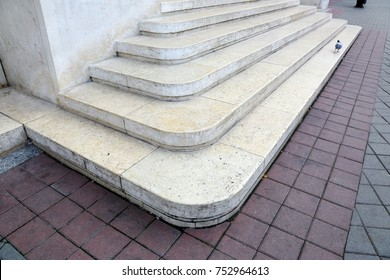 staircase of marble in front of the building entrance